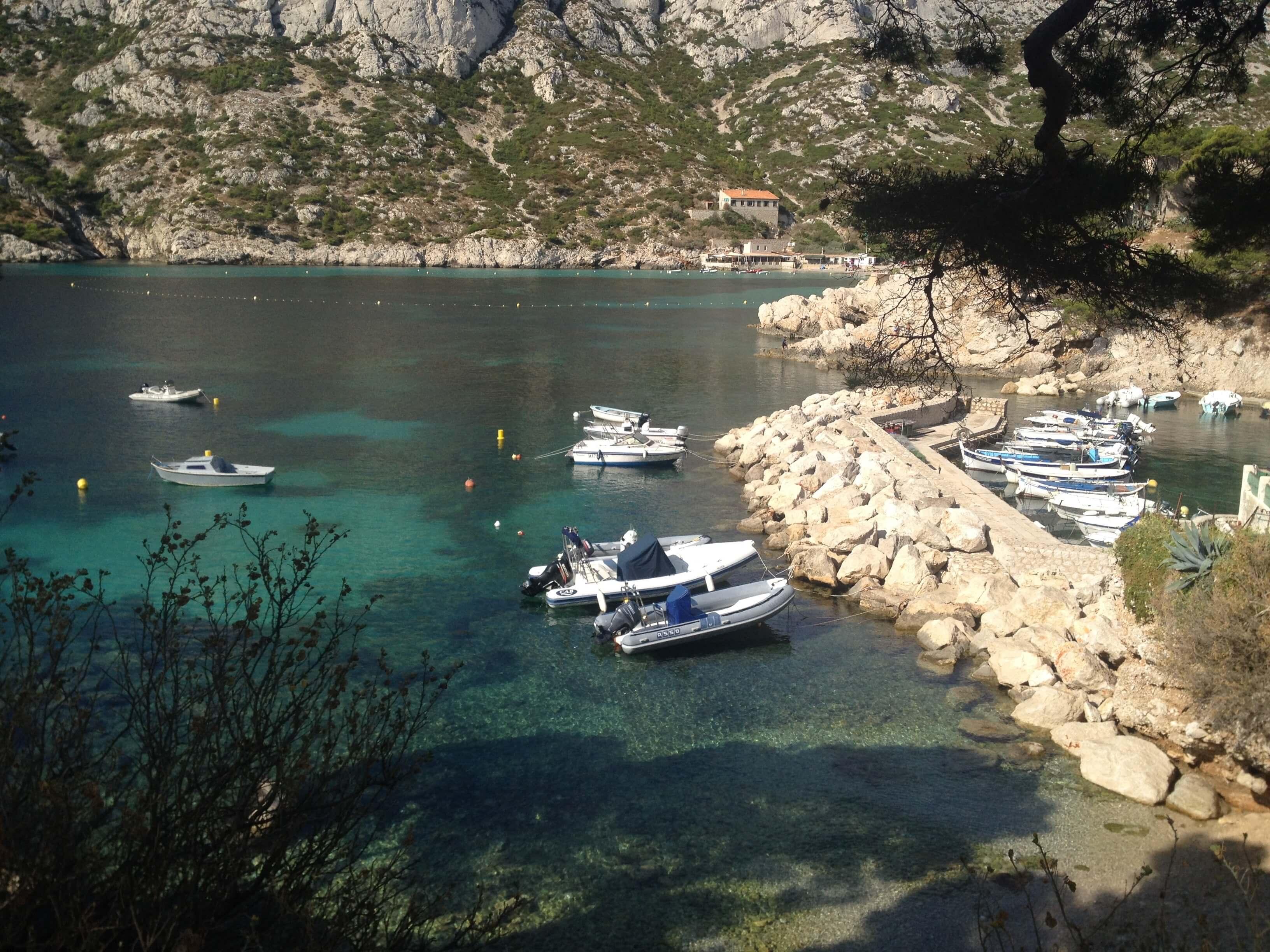 Boats parked in the cove at Calanque de Sormiou.