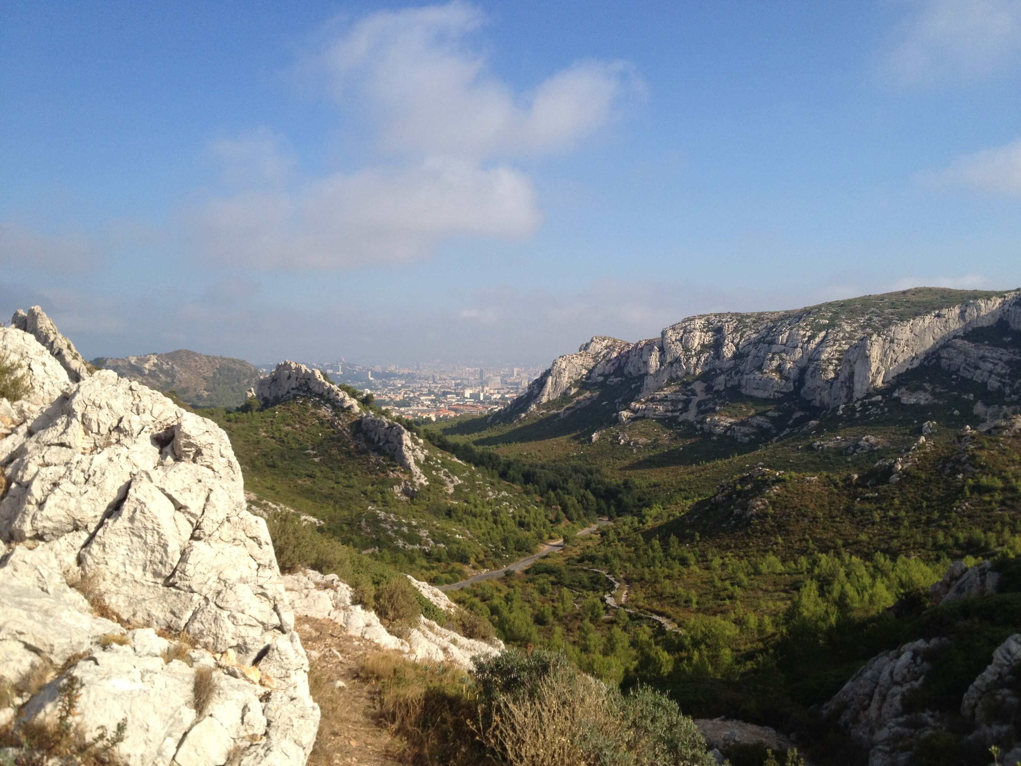 On one side... the view looking down on the climb up the mountain to Calanque de Sormiou with Marseille in the background.