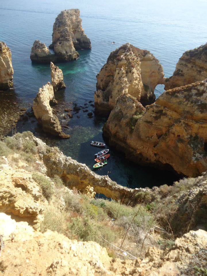 Boats at the bottom of the cliffs, Lagos, Portugal
