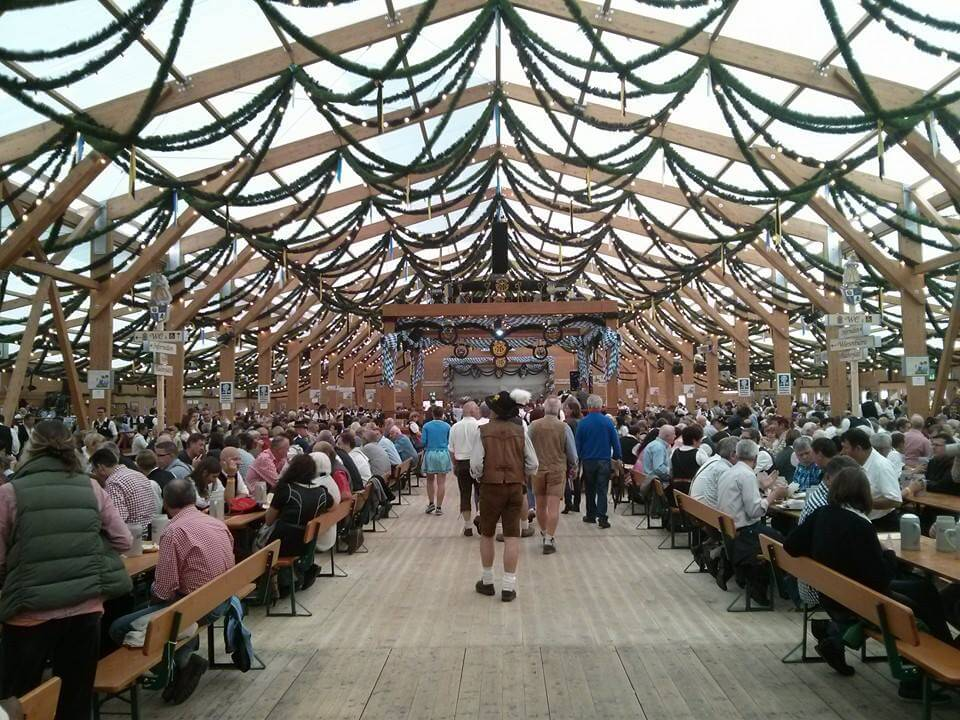 Inside Oktoberfest tent during the day.