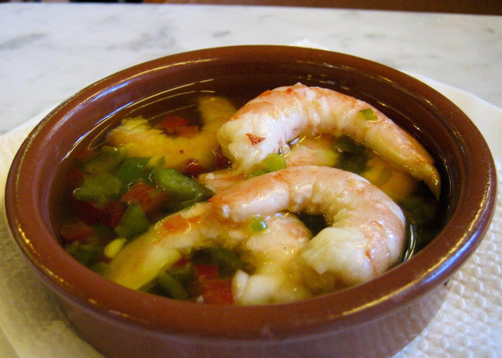 Tapa with shrimp, olive oil and pepper from Barcelona. Taken by Terence via Flickr .
