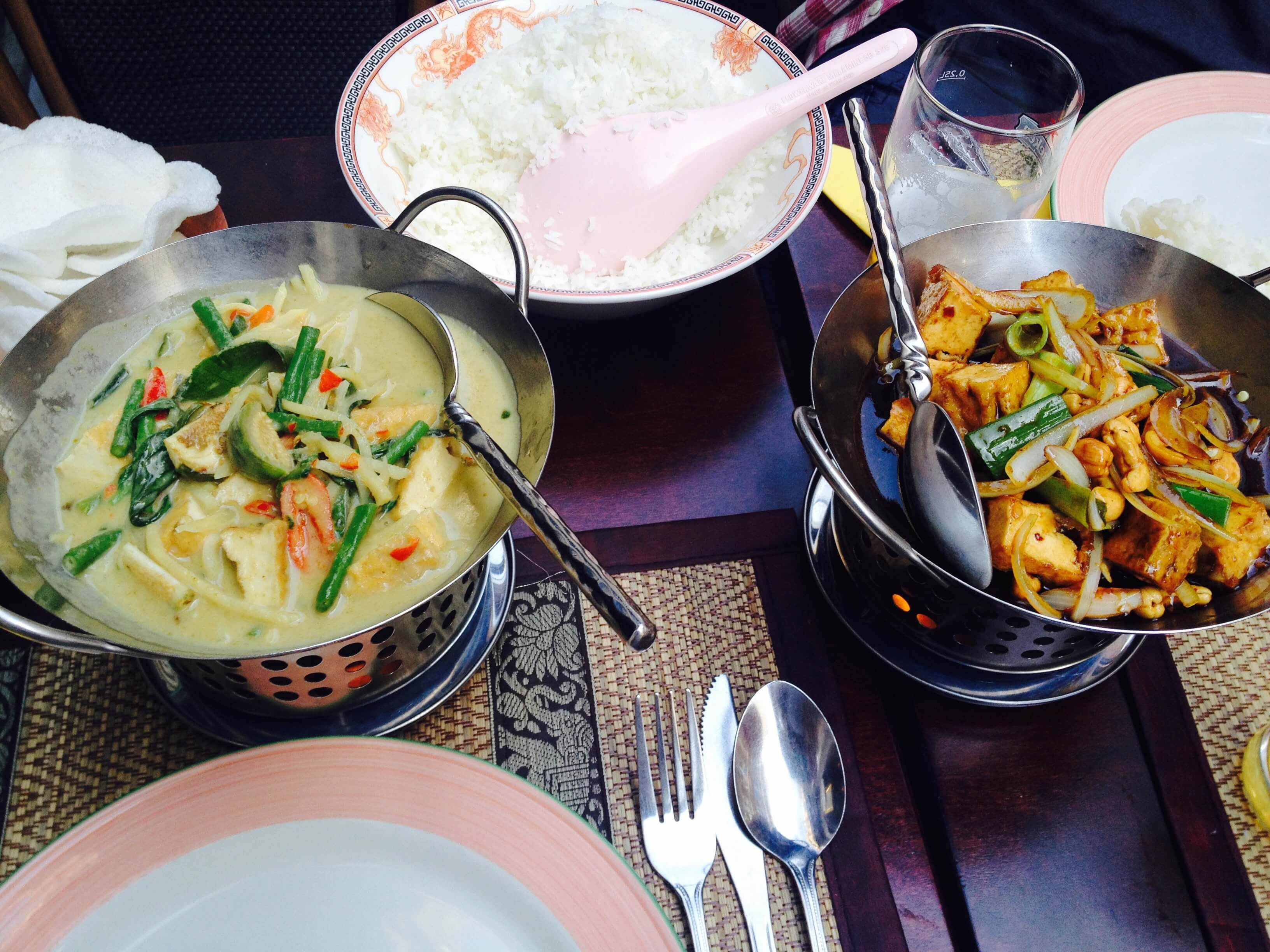Green curry with coconut milk and vegetables (left) and tofu with cashews in a sweet sauce from Thai Phutakun.