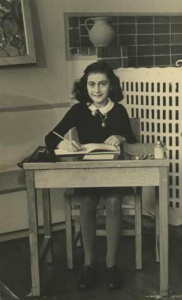 Young Anne Frank at School in 1940. By Unknown photographer; Collectie Anne Frank Stichting Amsterdam (Website Anne Frank Stichting, Amsterdam) [Public domain], via Wikimedia Commons.