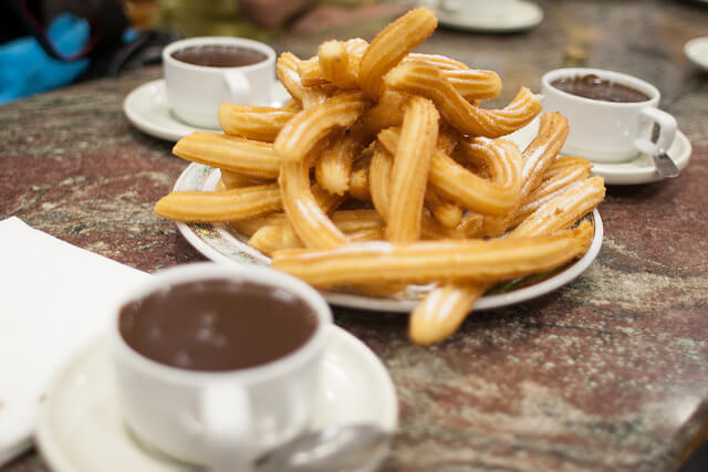 Some delicious churros con chocolate. Taken by Tim Lucas via Flickr.