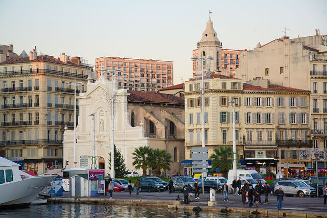 Marseille Old Port with Saint- Ferréol Les Augustins in the background. Taken by Ralf Smallkaa via Flickr.