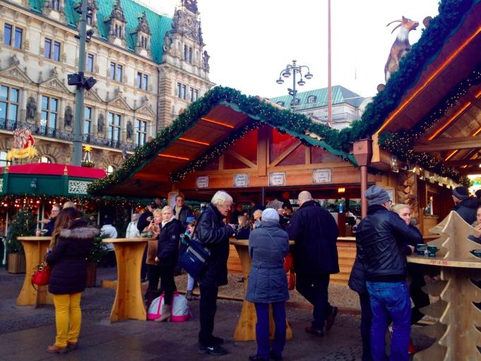 People having drinks at Hamburg Rathaus Christmas Market.