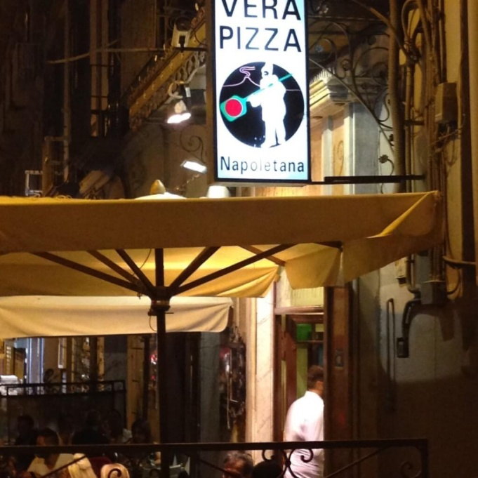 Vera Pizza sign in Naples.
