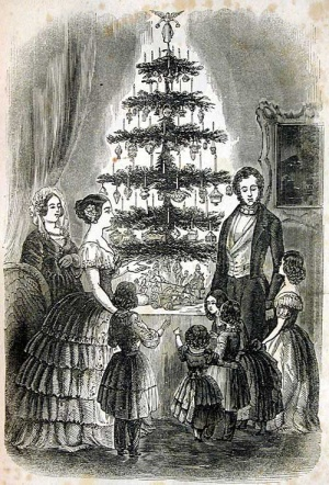 Queen Victoria and Prince Albert around their Christmas tree. By Godey's Lady's Book [Public domain], via Wikimedia Commons