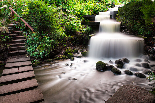 Waterfall at Japanese Garden, Planten un Blomen. Taken by Sarahhoa via Flickr.
